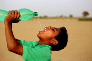 Indian boy drinking clean water